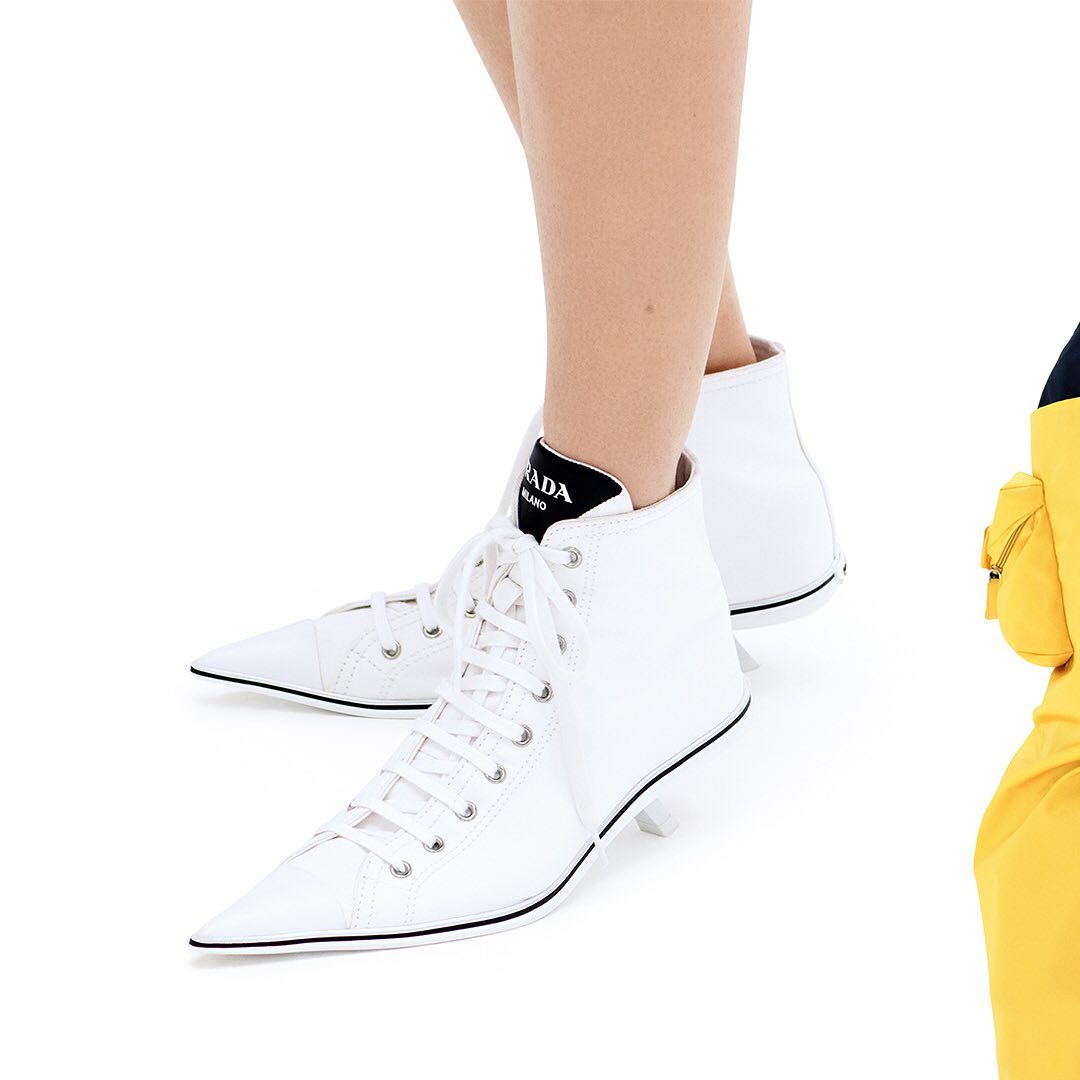 #PradaSynthesis heeled high tops and other #PradaSS21 pieces synthesize several ideas within sleek minimalism.